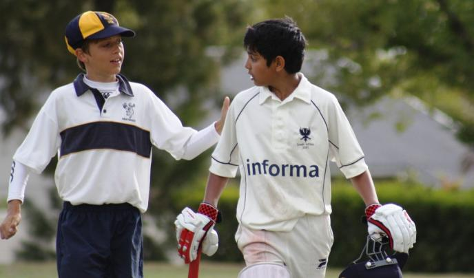 Bedford Prep School student congratulated after scoring a 50.