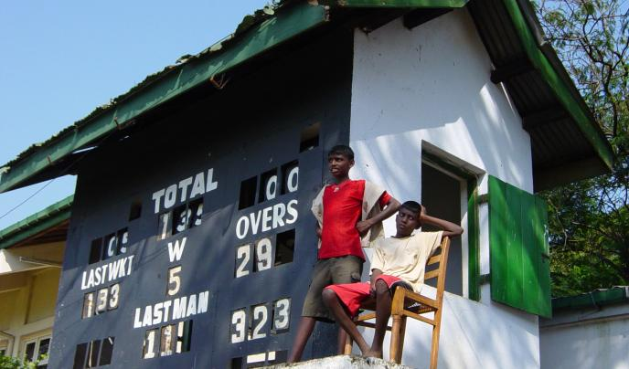 Sri Lankan players keep an eye on the score.