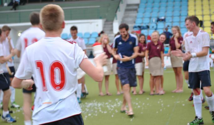 Boys and girls from Norwich School celebrate the end of their Malaysian hockey tour.