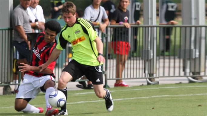A player puts up a fight for possession of the ball.