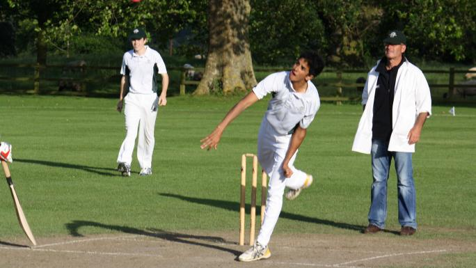 A Westminster player practices his bowling.