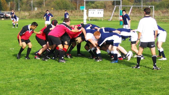 Players lock in a scrum in readiness for playing to restart.