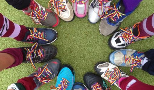 Players put their best foot first to support an anti-homophobia campaign.
