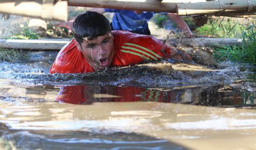 Having a dip: A pupil from King's School, Worcester, at Konka Camp.