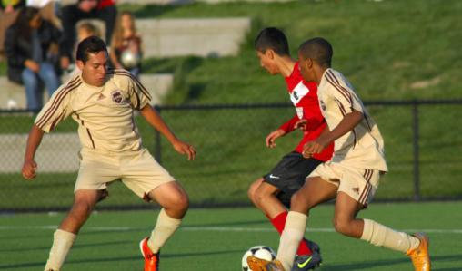 Battling for the ball: Ilford County High School play Livermore Fusion.