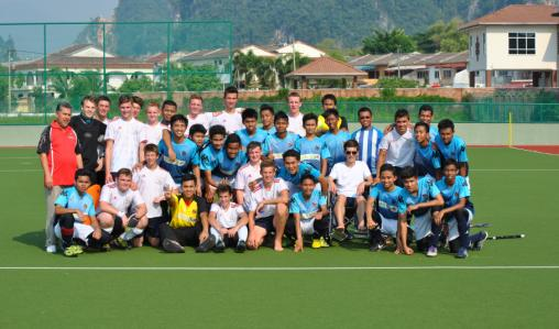 Players from Norwich School get friendly with the Malaysian side.