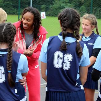 Netball girls from Bury Grammar School get some netball tips from England Captain Pamela Cookey