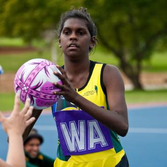 An Australian player on the attack playing netball in Melbourne.